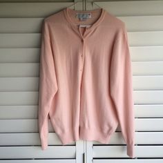 100% Cashmere Vintage Cardy This cardigan is a gorgeous peachy/pinky color. It is 100% cashmere. It is vintage. It was very well taken care of, however shows a little sign of wear. Clan Douglas Sweaters Cardigans