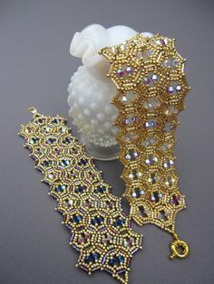 JEWEL OF INDIA PATTERN::    MATERIALS:  Size 2 bugle beads  size 11 and 15 seed beads  64 - 4mm bicone crystals  6 lb fireline  clasp  size 12 beading needle