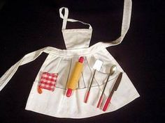 Vintage Barbie Fashion Pak Apron and Utensils (1962-1963)    Blue, Red or White Apron  Knife with Red Handle  Spoon with Red Handle  Spatula with Red Handle  Wooden Rolling Pin  Potholder