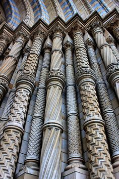Carved pillars at the Natural History Museum entrance, London I just thought this picture was really cool. Showing off all the columns in a row. Gothic Architecture, Beautiful Architecture, Beautiful Buildings, Architecture Details, Beautiful Places, Gothic Buildings, Architectural Features, Architectural Elements, Osnabrücker Land