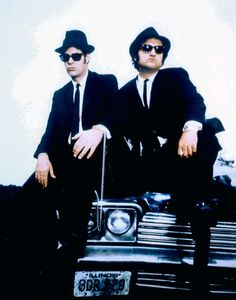 500 Pop Culture Halloween Costume Ideas The Blues Brothers From The Blues Brothers What to wear: White collared shirt, black suit, black sunglasses, and a fedora. How to act: Jam out on a harmonica all night. Blues Brothers Costume, Halloween Costumes For Brothers, Blues Brothers Movie, Pop Culture Halloween Costume, 80s Aesthetic, Halloween Disfraces, Back In The Day, Movies And Tv Shows, Movie Tv