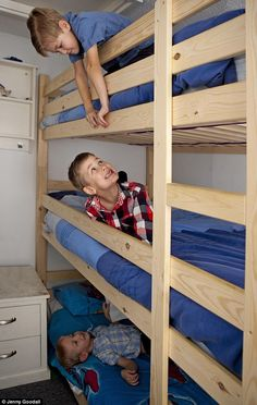 From top to bottom: Brothers Eddie (seven), Sid (six) and Paddy (four) share a triple bunk bed