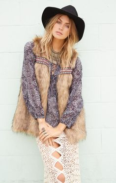 Modern hippie faux fur vest over boho chic ethnic inspired print peasant blouse top.  For the BEST Bohemian fashion trends FOLLOW https://www.pinterest.com/happygolicky/the-best-boho-chic-fashion-bohemian-jewelry-gypsy-/ now!