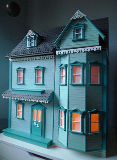 A teal house. Yes, please! Okay, I know it's just a dollhouse but a girl can dream.
