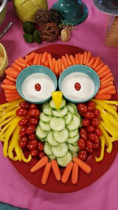 Owl shaped vegetable tray with ranch dip, baby carrots, yellow bell pepper, cucumber, and cherry tomatoes