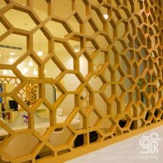 wooden cutout wall divider   I will make this one, white, with mirrors!