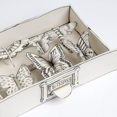 Butterfly and Bug Drawers - Katharine Morling is an award-winning artist working in the medium of ceramics. She creates sculptures in porcelain in her signature monochromatic aesthetic.