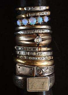 Old rings from Erie Basin. I love the opal one. And all the rest.
