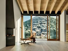 Sun Valley House Rick Joy Architects Sun Valley, Idaho Most of the windows frame far-off vistas. The exception is the sliding glass door in the master bedroom. It offers a view of a brush-covered hillock that rises just a few feet away. The rafters and the flooring, both of Douglas fir, run in the same direction and lead the eye outside.