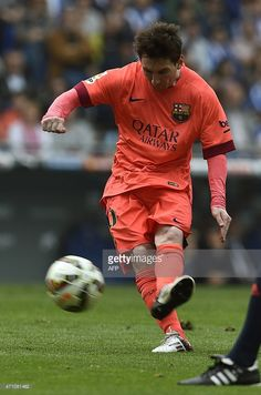 Barcelona's Argentinian forward Lionel Messi kicks a ball during the Spanish league football match RCD Espanyol v FC Barcelona at the Cornella-El Prat stadium in Cornella de Llobregat on April 25, 2015.