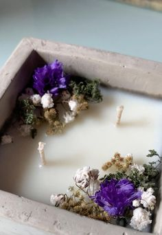 Handmade and decorated floral garden soy candle made as a gift to someone this holiday season. Do we like these rustic square cement containers? Should we make them available on our site? What do you guys think.. #handmadecandle #handmadehomedecor #driedflorals #soywaxcandles #candlemaking #holidaygiftideas #floralart #candlemakingbusiness #christmasgifts Diy Candles Scented, Homemade Candles, Vegan Candles, Soy Candles, Diy Candles Video, Candle Making Business, Soy Candle Making, Rustic Candles, Candle Craft