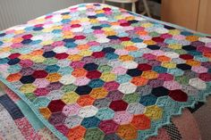 Weekender Blanket, free written pattern with stitch diagrams by Sandra Paul (Cherry Heart). Includes half-hexes, instructions for adding straight edge (not pictured here), & border. Links to two blog posts on Ravelry page if you'd like more details about yarn, colors, etc. . . . . ღTrish W ~ http://www.pinterest.com/trishw/ . . . . #crochet #afghan #throw #hexagon