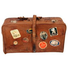 This one-of-a-kind suitcase offers chic, vintage appeal in your home or on the go. Made from rich, naturally distressed leather, this gorgeous bag was crafted in the 1950s, showcasing hotel labels from around the world. #jossandmain