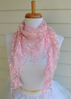 Gorgeous pink lace scarf. Scarf is a triangle shape, like a shawl, and has beautiful details.