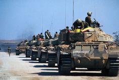 Israeli tanks head down the road to Damascus.