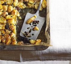 Crispy new potato bake: A crisp and juicy rustic side dish, peppered with tangy olives and capers