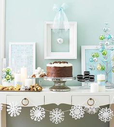 Really like the clean look of this dessert table with the snowflakes and white frames.