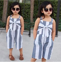 This Bow Stripped Jumpsuit is a new arrival and every mini fashionista needs one! Link in bio! African Dresses For Kids, Dresses Kids Girl, Kids Outfits, Kids Dress Wear, Kids Gown, Frocks For Girls, Kids Frocks, Baby Girl Fashion, Fashion Kids