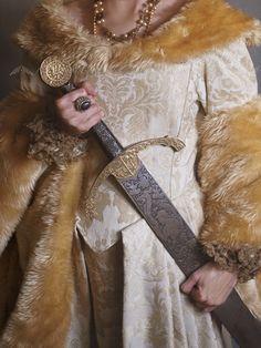 Historical woman holding a sword.BY: Malgorzata Maj