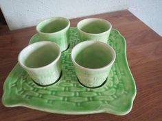 Four Green Egg Cups on a 'Tray'