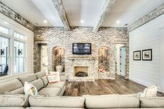 An exposed brick wall in a room doesn't always mean industrial. Moreover if we talk about the specific white brick wall, the style and design it suits will be way more than just one kind. Accent Walls In Living Room, Home Living Room, Living Room Designs, Brick Interior, Interior Design, Farmhouse Family Rooms, Modern Farmhouse, Farmhouse Decor, Farmhouse Front