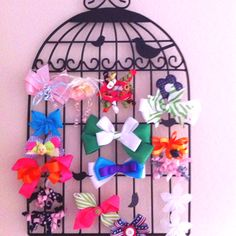 Simple metal birdcage wall hanging used as a hair bow holder!