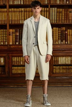 Trussardi brings a certain sportiness to the suit for spring. The traditional wardrobe staple is made current and modern with slouchy shorts and the addition of a casual tee.