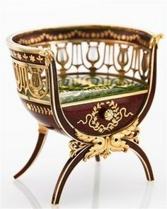 """Faberge miniature imperial chair, just over 2"""" tall. Made between 1899 and 1903. Sold by Sotheby's for 2.8 million dollars. Faberge miniatures of furniture are very rare. Made of Gold"""