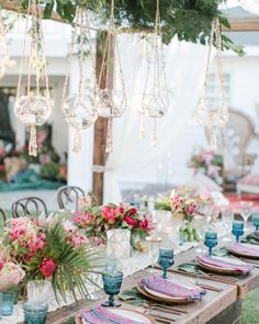 Inviting Occasions used textile napkins and tropical flowers including gloriosa lilies, orchids, ferns, and roses,