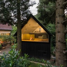 Derelict shed converted by Sue Architekten into writer's studio and playroom
