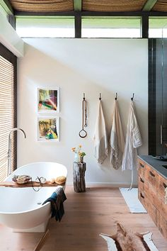 Check Out Athena Calderone's Covetable Home — & Steal Her Ideas #refinery29  http://www.refinery29.com/eye-swoon/6#slide8  Ah, my master bathroom. Certainly the most swoon-worthy moment in the house. The resin floating tub is from Signature Hardware. The vintage rusted hooks purchased on eBay hold Turkish fouta towels.