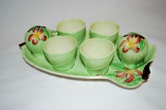 Carlton Ware breakfast egg cups with salt and pepper shakers on tray.
