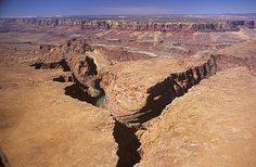 Steamboat Rock, Arizona; marble canyon sector of Grand Canyon National Park on the Colorado River with the Vermillion Cliffs in the distance.
