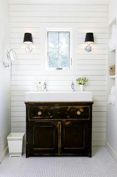 black vanity, white panel wall