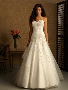 This is beautiful and has a lot of what I've been looking for!  Allure 2462 now does it have the laced up back and it's perfect!:)