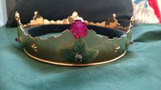 Ducal coronets. Ruby rose and Jade leaves were carved by Master Aenerin Peabody.