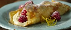 Mmm! Light as a feather crepes with a creamy filling and fresh berries.