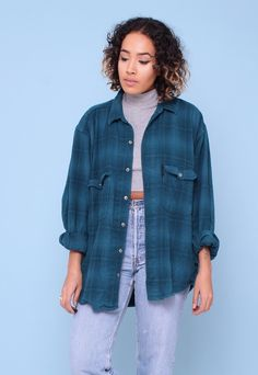 """Vintage 90s Checked Boyfriend Flannel Shirt. Buttons down the front. Breast pockets. Long sleeves (shown rolled up). Oversized fit. CONDITION: Excellent with signs of natural wear/age as to be expected with all vintage garments. SIZING: ONE SIZE Full Length: 29"""" Bust: 44"""" Sleeve: 22"""" Shoulder to Shoulder: 20"""" (OUR MODEL: 5'7 10/12) Don't forget FOLLOW our boutique for fresh new items added daily!"""