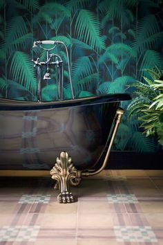 Copper clawfoot rolltop bath and Cole & Son Palm Jungle wallpaper in the bathroom at The Corner Townhouse in Rome, Italy. Tropical Bathroom, Tropical Home Decor, Tropical Houses, Bohemian Bathroom, Tropical Interior, Bathroom Wallpaper, Of Wallpaper, Bathroom Mural, Bathroom Bath
