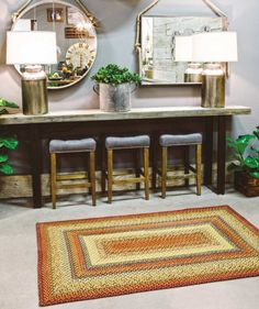 """Graceland Rectangle Braided Floor Runner 2'6""""x6'  Measures 2'6""""x6' Colors: barn red, green, creme, rust, mustard and slate Made from 100% natural jute Spot clean only  Enjoy creating a simple yet love"""