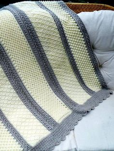 In this 6 - Stitches Aran Throw crochet pattern we will find 6 stitches pattern included! Popcorn stitch, Diamond stitch, Cable stitch, Arrow stitch, Celtic Weave and Basketweave.