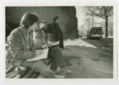 Mary E. Stevens '86 and two other students waiting for the Five College Bus at the bus stop near Mary Woolley Hall :: Archives and Special Collections Digital Images :: circa 1985-1986