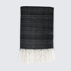This thick blanket is handwoven by artisans in Peru using 100% luxe baby alpaca, all made start-to-finish in a fair trade environment.