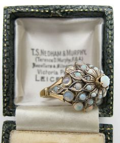 "Striking and whimsical vintage multi-gem ""princess"" ring encrusted with authentic vibrant opals in a 14 carat gold setting"