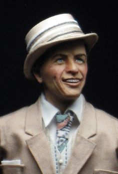 side view of Frank Sinatra. I asked Sharon to make Frank as he looked in the mid 50's with the fedora, tie, suit and those blue eyes! She and I agree this is her best sculpt so far. He is joining his Rat Pack pal Sammy Davis Jr. who is visiting Archie and Edith Bunker in their home. I got the idea from the episode he guest starred in All in the Family. Now I added Frank. Go take a visit!