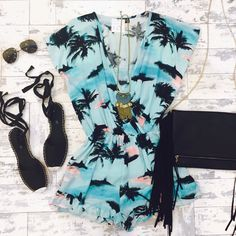 Wishing we were at the beach in the Island Sunrise Romper ($29.99) at #4thandocean, Lace Up Espadrille Flats ($19.99), Sunnies ($9.99) both from #statements, and Black Fringe Bag ($29.99) also at #4thandocean! All online as well // #sophieandtrey #ootd #island #romper #tropical #summer