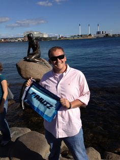 Russell with The Little Mermaid statue in Copenhagen, Denmark.