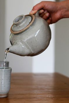 This beautiful grey teapot is wheel thrown and finished by hand. It is made from stoneware clay, celadon glazed gas reduction.  The teapot