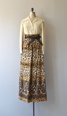 Vintage late 1960s Donald Brooks two-piece outfit with cream rayon crepe blouse, large collar, long faux leopard skirt with very high waist, brown