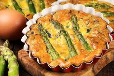 Preheat the oven to 450F/230C/Gas Mark 8. Trim the ends from asparagus and cut…